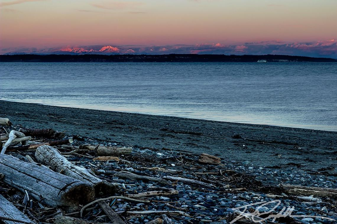 A view from Fort Worden State Park in Port Townsend of the sunset with Mt Baker in the background. (Photo: James Campbell)